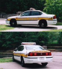 This patrol vehicle is a 2001 Chevrolet Impala.