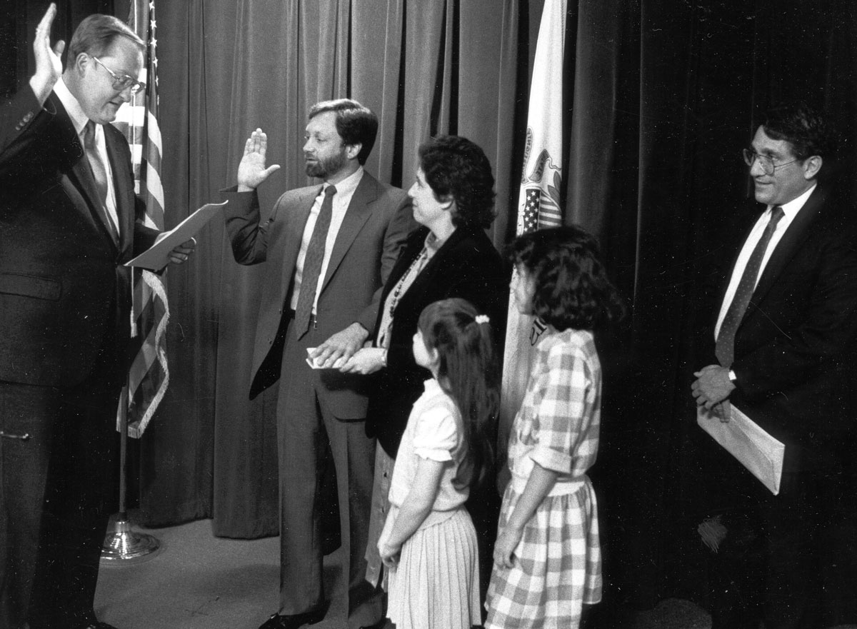 Director Margolis taking oath by Governor Thompson 1980s