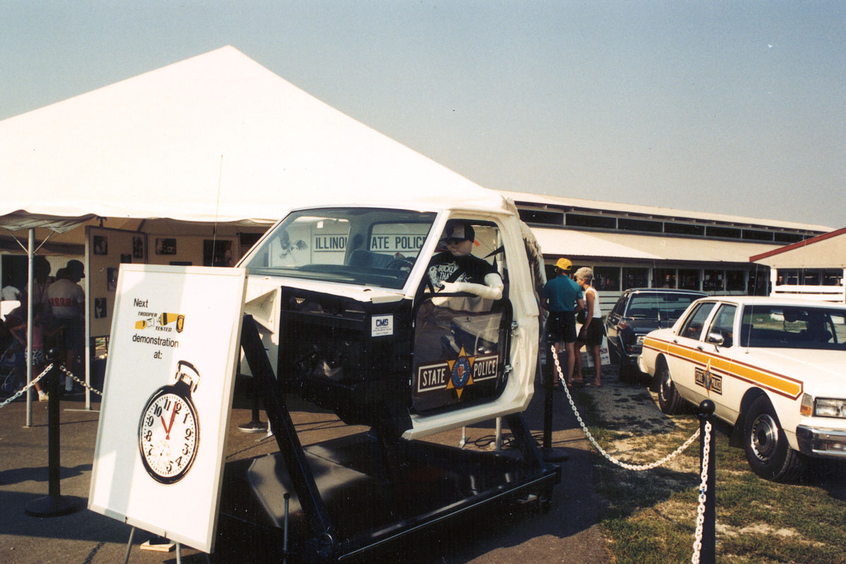 State fair ISP tent – public information and education – seat belt convincer – 1980s